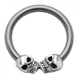 Piercing anneau 1,6mm 34 - Deux crânes